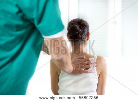 Chiropractor massage the female patient spine and back
