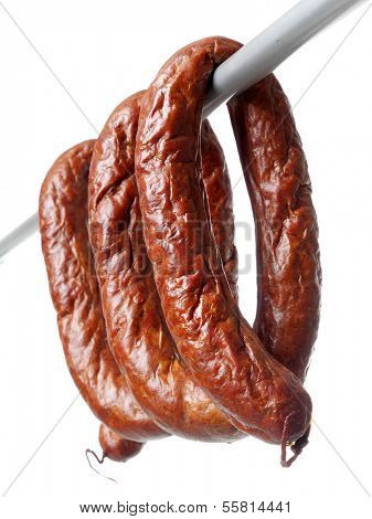 Polish sausage loops over white background