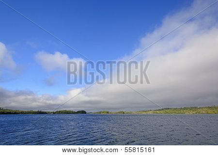 Clearing Skies On A Wilderness Lake