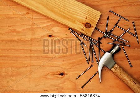 Hammer And Nails On Plywood