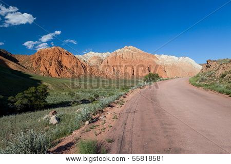 Road and eroded mountains in Kyrgyzstan