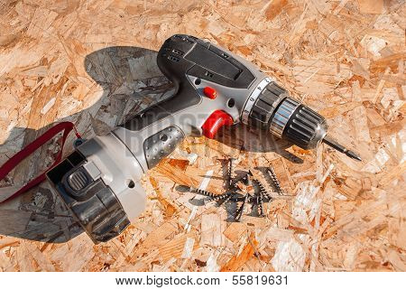 Hand Screwdriver And Screws