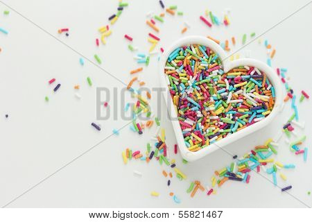 Heart shaped cookie cutter with candy sprinkles