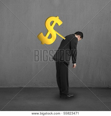 Businessman With Money Symbol Winder On His Back, Concrete Background