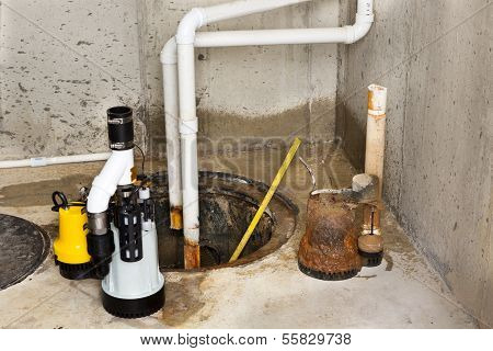 Replacing The Old Sump Pump In A Basement