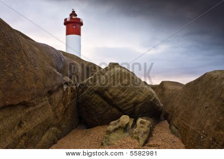 Lighthouse On Rocks