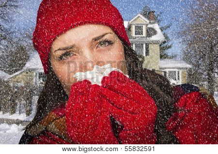 Miserable Sick Woman In Falling Snow Blowing Her Sore Nose With Tissue Outside.