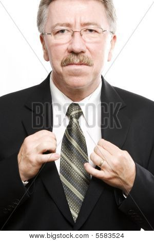 Older Business Man Showing His Tie