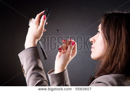 Businesswoman Holding Pocket Computer
