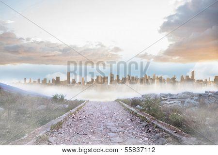 Rocky path leading to large urban sprawl