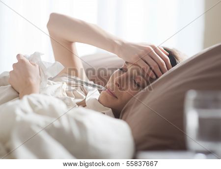 Woman Lying Sick In Bed