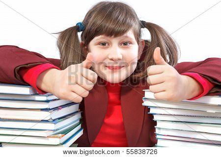 Schoolgirl, Schoolwork And Stack Of Books