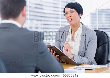 Female recruiter checking the candidate during a job interview at office