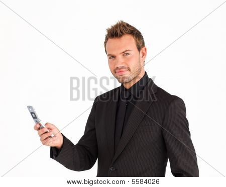 Businessman Writing A Message And Looking At The Camera