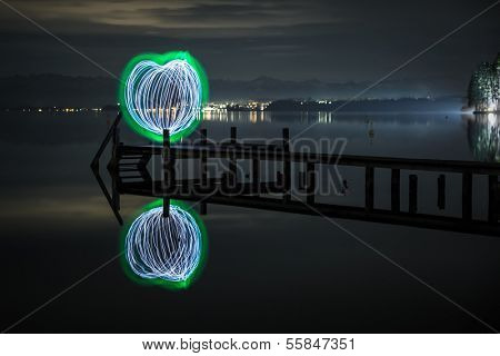 An image of a green heart of light at the Starnberg Lake in Germany