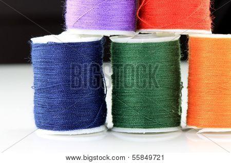 Colored thread spools