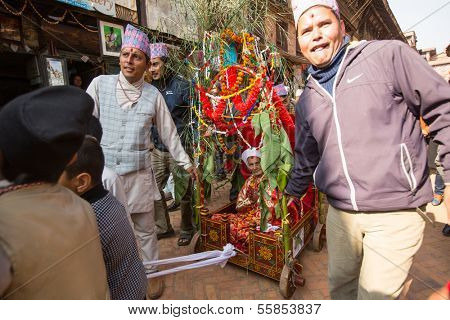 BHAKTAPUR, NEPAL - DEC 20: Unidentified people during Birthday celebration head of family - 77 years 7 months 7 days 7 hours old, like rebirth according to Newar, Dec 20, 2013 in Bhaktapur, Nepal.