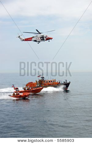 Lifeboat / life boats and rescue helicopter of the R.N.L.I. coastguard near Worthing Pier, UK