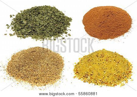 Piles of different spices  Isolated On White Background.