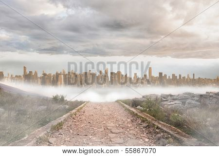 Stony path leading to large urban sprawl