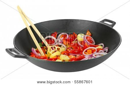 Vegetables in wok isolated on white