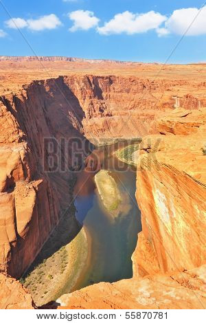 The well-known river Colorado is picturesquely bent in the Horseshoe. The high and abrupt coast dangerously breaks over green water of the river