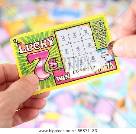 BOISE, IDAHO - DECEMBER 21, 2013: A Lucky 7 scratch ticket being played in hopes of winning a cash prize