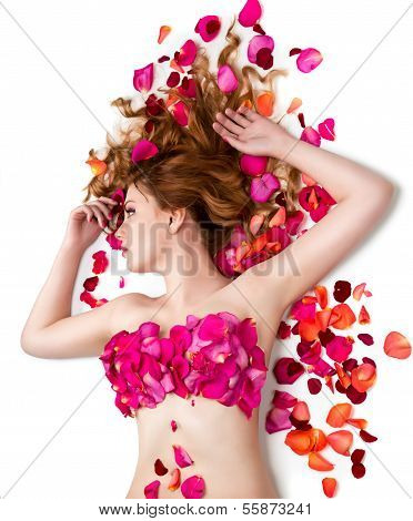 Female waxing armpit in a beauty salon. Ideal smooth clear skin. Beautiful woman lying in rose petal