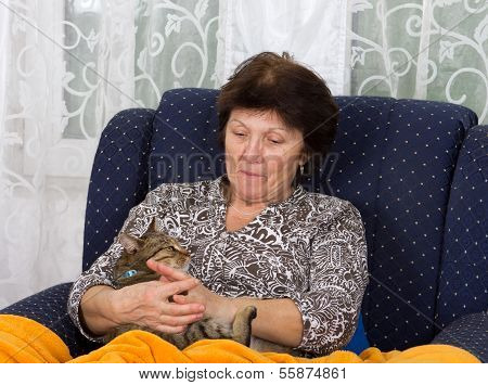 Woman Cuddles Cat