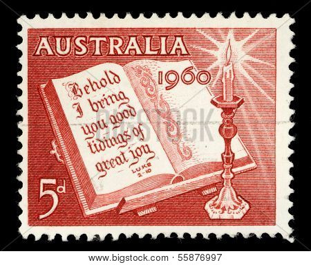 AUSTRALIA - CIRCA 1960: A stamp printed in Australia from the Christmas issue shows Open Bible and Candle, circa 1960.