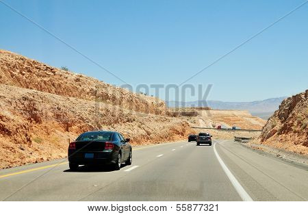 Cars On The The Desert Road Through Nevada