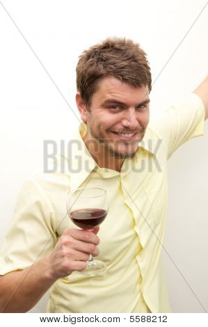 Young Man Toasting With A Glass