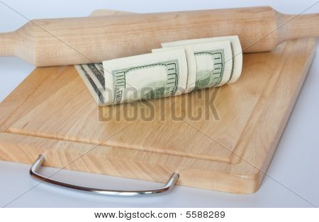 Dollar On Cutting Board