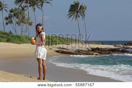 Girl with coconut cocktail