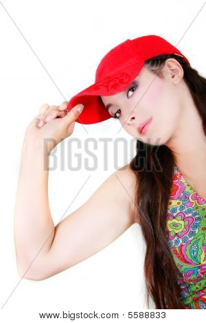 Attractive Girl In Red Cap Over White