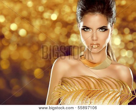 Fashion Beauty Girl Isolated On Golden Bokeh Background. Makeup. Gold Jewelry. Hairstyle. Vogue Styl