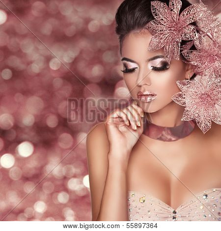 Beautiful Girl With Pink Flowers. Beauty Model Woman Face. Isolated On Bokeh Lights Background.  Per