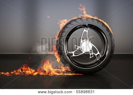Tire burnout with flames smoke and debris,concept.
