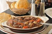 stock photo of biscuits gravy  - Closeup of beef stew with fresh baked biscuits - JPG