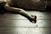 foto of suicide  - Cropped image of a woman lying on the floor - JPG