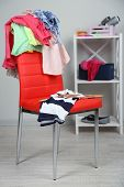 foto of slut  - Heap of  clothes on color chair - JPG