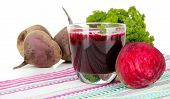 Fresh juice of beets on table on white background