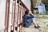 foto of child abuse  - Teens problems teenager alone at the city - JPG