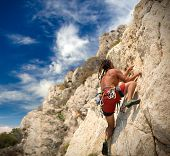 image of climb up  - Young man climbing - JPG