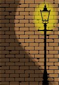 stock photo of edwardian  - A typical old London gaslight set against a worn brick wall with shadow - JPG