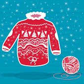 image of knitwear  - Red knitted christmas sweater and a ball of yarn on blue background - JPG