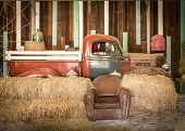 picture of truck farm  - background interior design of an old country house decorating brown sofa and red pickup inside the room - JPG