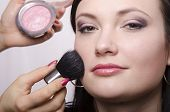 foto of face-powder  - Makeup artist in the process of makeup - JPG