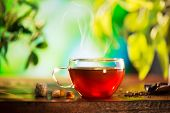 stock photo of teapot  - Cup of Healthy Tea over Blurred Nature Green background - JPG
