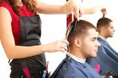 foto of beauty parlor  - Beautiful girl hairdresser cut guy in beauty salon - JPG